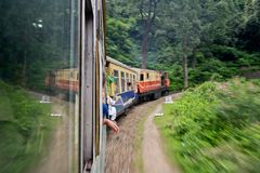 Train from Kalka to Shimla. SHIMLA, HIMACHAL PRADESH, INDIA - JULY 21: Fast moving old train from Kalka city to Shimla in mountains on July 21, 2013 Royalty Free Stock Images