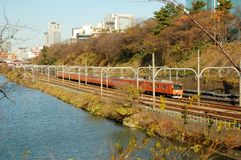 Train by Lake in Tokyo. Train passing by at the lake in Tokyo, Japan Royalty Free Stock Image