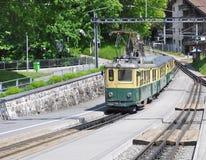 Train from Lauterbrunnen moves to Kleine Scheidegg. Stock Image