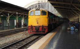 A train leaves Bangkok Hua Lamphong station stock image