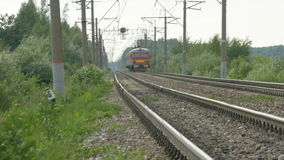 The train leaves far along the rails. The railway is distorted by the heat. Marevo stock video footage