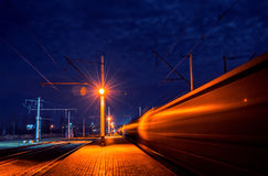 Train leaves the station. With speed Royalty Free Stock Photography