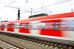 Train leaves the station with speed Stock Photography