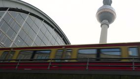 Train leaving Alexanderplatz Station by the Television Tower, Berlin, Germany. Train leaving Alexanderplatz Station by the Television Tower, daytime, Berlin stock video footage