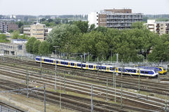 Train leaving central station Rotterdam Royalty Free Stock Images