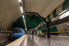Train leaving Huvudsta metro station in Stockholm Royalty Free Stock Image