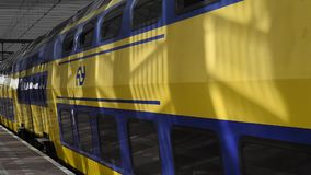 Train leaving at the platform in Rotterdam. Rotterdam, The Netherlands - March 10, 2017: Train leaving at the platform in railway station Rotterdam in the stock video footage