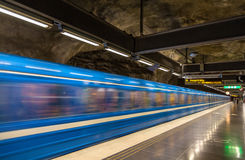 Train leaving Stadshagen metro station in Stockholm Royalty Free Stock Photo