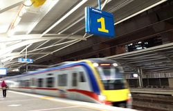 Train leaving station platform number one Royalty Free Stock Photography