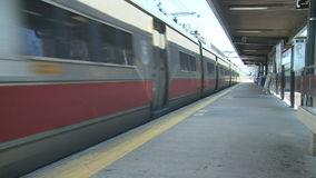 Train leaving the station.  (1 of 2). A view or scene from around town stock video footage