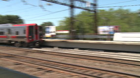 Train leaving the station.  (2 of 2). A view or scene from around town stock video footage