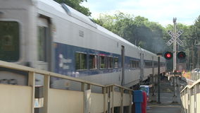 Train leaving station. A view or scene of Transportion stock footage