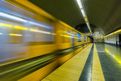 Train leaving subway station Royalty Free Stock Image