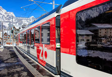 Train leaving the town of Engelberg in Switzerland Royalty Free Stock Image