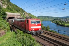 Train leaving tunnel near river Moselle in Germany Stock Image