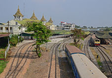 A train is leaving the Yangon Central Railway Station on the railway tracks Stock Photos