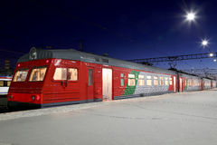 Train on Leningrad railway station at night -- is one of the nine main railway stations of Moscow, Russia Stock Photography