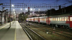Train on Leningradsky railway station at night -- is one of the nine main railway stations of Moscow, Russia.  stock video footage