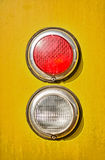 Train light detail. Light train detail of two lights on yellow background royalty free stock photo