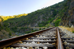 Train line. Old rusty train line near a river stock photography