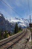 Train line running through the Swiss Alps Royalty Free Stock Images