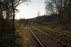 Train line into the sunset Royalty Free Stock Photo