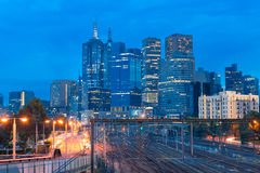 Train lines leading in to the Melbourne CBD. Against a blue night sky Stock Photo