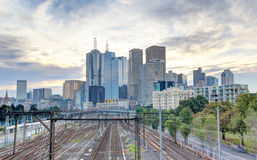 Train lines leading in to the Melbourne CBD. With the sun setting in the background Royalty Free Stock Photos