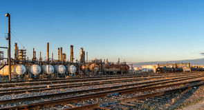 Train liquid cars in a Refinery. Train liquid cars in a oil refinery in Montreal at sunset Royalty Free Stock Image