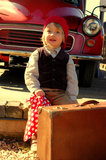 Boy and vintage car. Little boy dressed in vintage cloths, waiting for the train near vintage car Stock Image