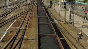 Train loaded with coal. Moving freight train with coal. Haulage and logistics stock video