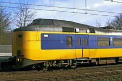 Train locomotive. Dutch public transit yellow and blue train and tracks royalty free stock photo