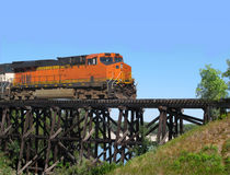 Train locomotive crossing a trestle. Stock Photo
