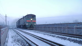 Train locomotive in fog, cold winter day. Train (locomotive) in fog in  cold winter day stock video