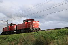 Train locomotive for freight train of DB is running at the railroad track in Nieuwerkerk aan den IJssel in the Netherlands.  stock photos