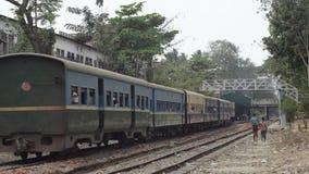 TRAIN LOCOMOTIVE: Medium shot of multicolor train passing stock video footage