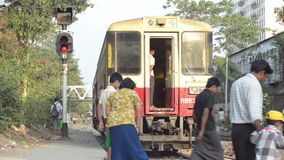 TRAIN - LOCOMOTIVE: Passengers walk close to departing train. TRAIN LOCOMOTIVE: Passengers walk close to departing train; from ' Diesel Train in Myanmar  (Asia stock video