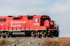 Train locomotive passes through rural Ontario, Canada. Royalty Free Stock Photography