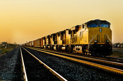 Train locomotive traveling through desert Royalty Free Stock Images