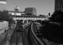 Train in london. Black and white train in london with sky and buildings stock image