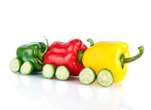 Train made of various sweet pepper vegetables and cucumbers Royalty Free Stock Photography