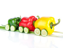 Train made of various sweet pepper vegetables and cucumbers Royalty Free Stock Photo