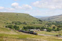 Train in Mallerstang valley on Settle to Carlisle Stock Photos