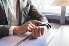 In the train a man using his smartwatch. Close-up hands Royalty Free Stock Image