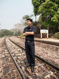 Train Master in Natural Railway Setting Stock Image