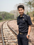 Train Master in Natural Railway Setting Royalty Free Stock Image