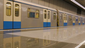 The train in the metro, closes the door and leaves the station. An empty platform, no people. stock footage