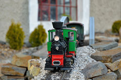 Train model. Beautiful realistic train model. Old red and green locomotion with wagons, train driver on metal rails. Slovakian tourist attraction in Cierny Balog Royalty Free Stock Photo