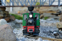 Train model. Beautiful realistic train model. Old red and green locomotion with wagons, train driver on metal rails. Slovakian tourist attraction in Cierny Balog Stock Image