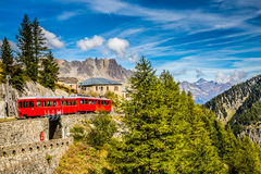 Train In Montenvers Mer de Glace-Chamonix,France. Beautiful View Of Red Train Going To Montenvers Mer de Glace Station During Summer Day-Mont Blanc Massif stock photos